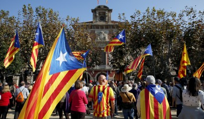 Catalan separatist supporters wait for the voting results in front of Catalunya's Parliament, as Catalonia's regional government debates in favor of a resolution to split from Spain in Barcelona