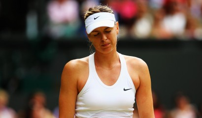LONDON, ENGLAND - JULY 01:  Maria Sharapova of Russia stands dejected during her Ladies' Singles fourth round match against Angelique Kerber of Germany on day eight of the Wimbledon Lawn Tennis Championships at the All England Lawn Tennis and Croquet Club on July 1, 2014 in London, England.  (Photo by Al Bello/Getty Images)